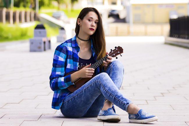 girl playing ukelele