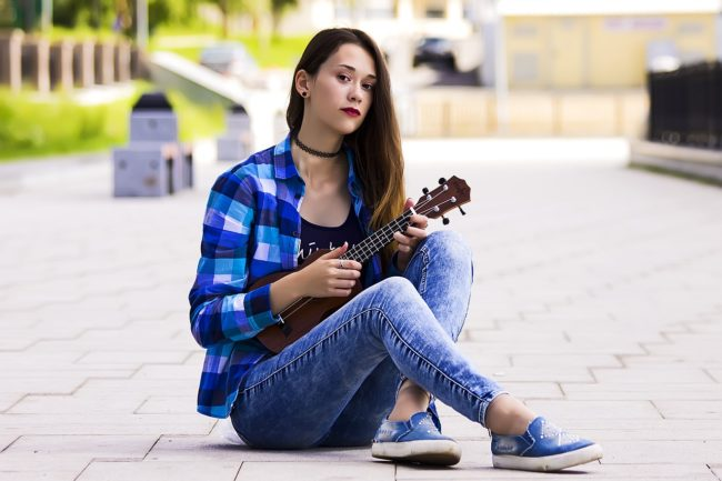 girl playing ukelele